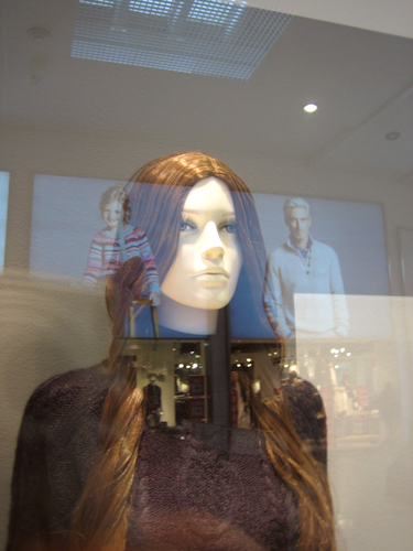 Mannequin in shop window.