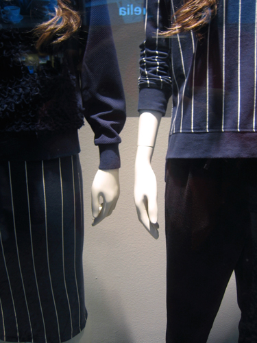 Mannequins in shop window.